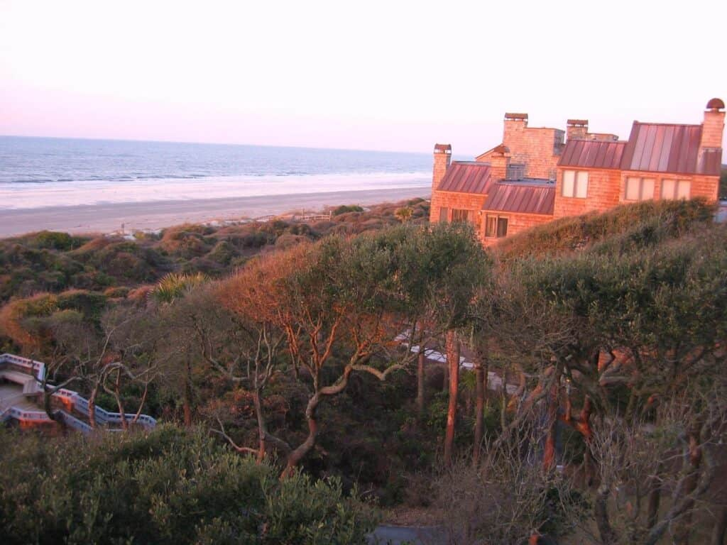 Image of oceanfront vacation rentals at sunset